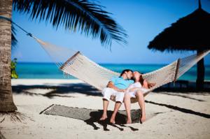 Romantic couple relaxing in hammock