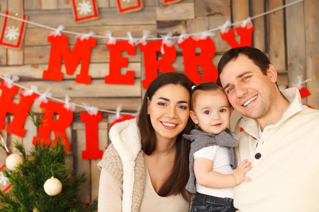 family posing for christmas photo
