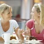 women enjoying dessert