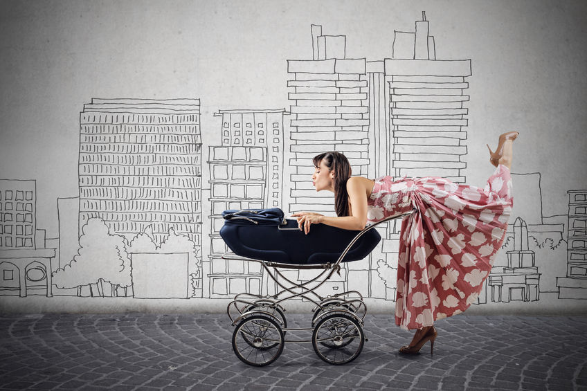 doting au pair bending over baby carriage against illustrated city background