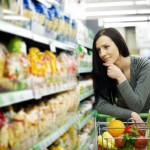 woman at grocery store looking at shelves