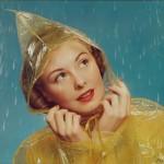 women in rain wearing a raincoat