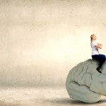 Conceptual image of young pretty woman riding human brain