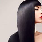 Hair. Beautiful Woman with Healthy Long Hair. Red Lips and nice Makeup. Black Hair