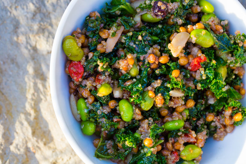 Raw paleo quinoa kale salad in a bowl