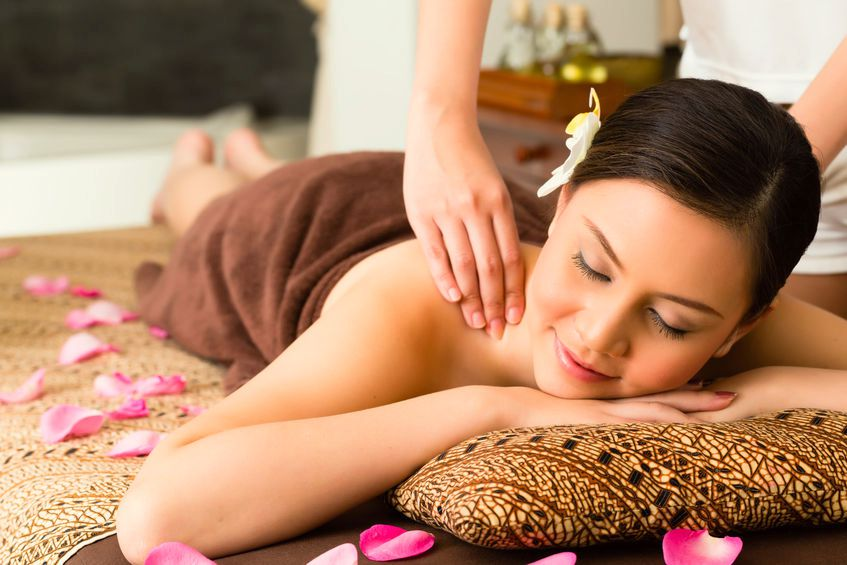 Asian woman in wellness beauty spa having aroma therapy massage with essential oil, looking relaxed
