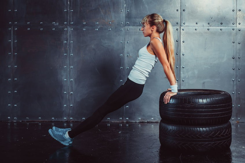 athlete woman doing push-ups on bench training triceps athlete woman doing push-ups on bench training triceps athlete woman doing push-ups on bench training triceps