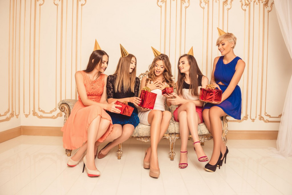 group of girls celebrating birthday sitting on the sofa