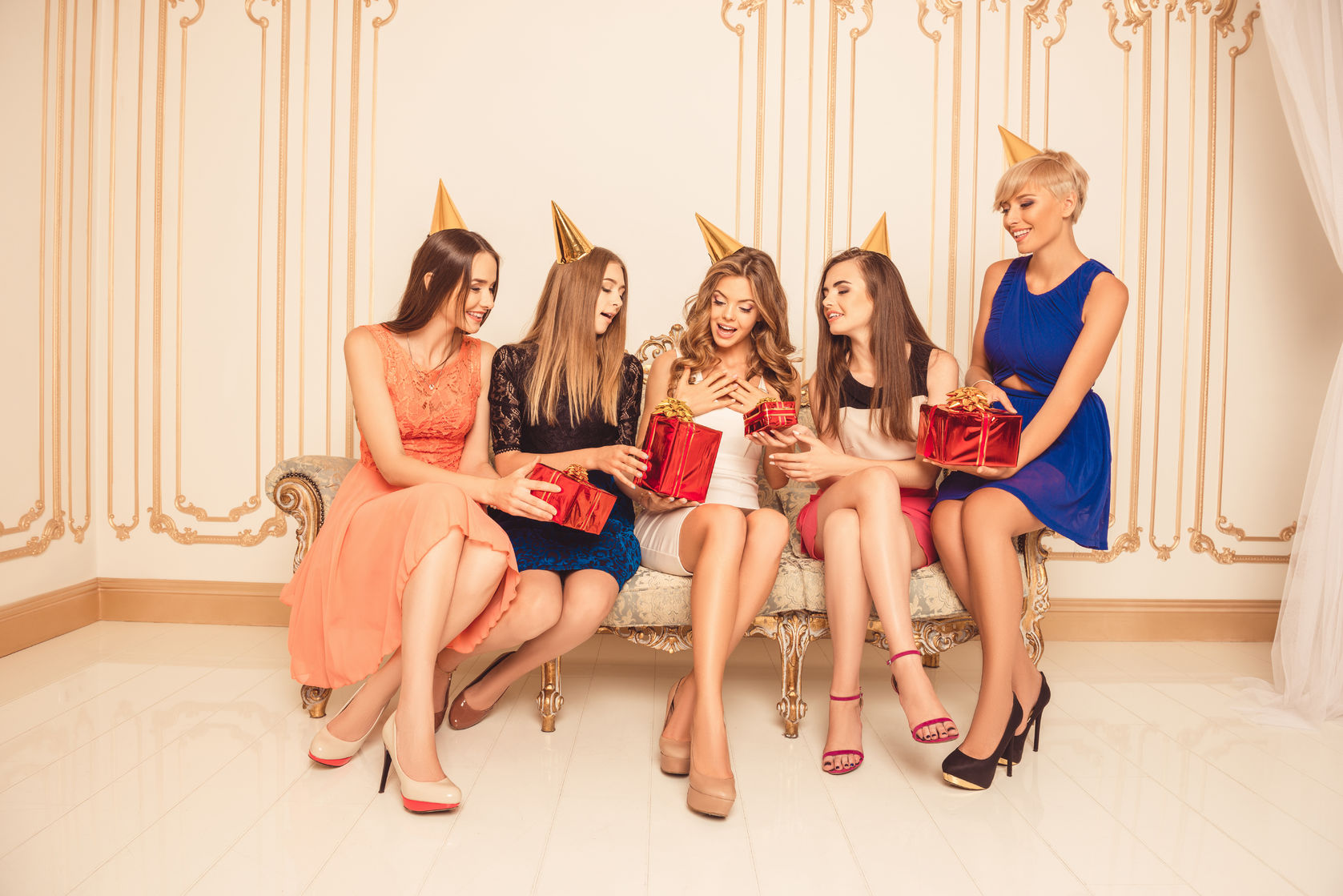 group of girls celebrating birthday sitting on the sofa
