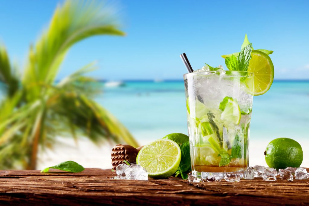 mojito drink against a beach backdrop