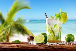 mojito drink against a beach backdrop